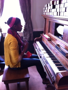 Nay'Chelle playing the piano.