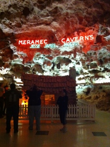 The entrance to the cave. The house is a replica of Jesse James' house.