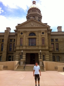 At the Wyoming State Capitol in Cheyenne. While I did not meet the governor, I was allowed to snag a pen and a pin from his desk.