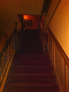 Creepy staircase. Is that red light an orb of demonic energy or is it just the lighting?