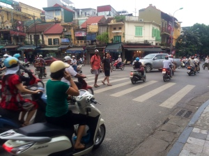 Dili and Dor learn how to play Frogger on the streets of Hanoi