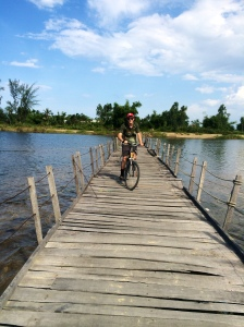 Biking on a rickety floating bridge