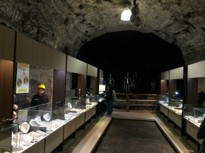 A jewelry store set up in the Salt Cathedral. All the workers wore yellow helmets. My favorite part of this picture is the tile floor that apparently signifies that this is a jewelry shop.
