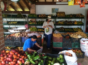 Colombian Dave Grohl picking out fruit at a roadside market