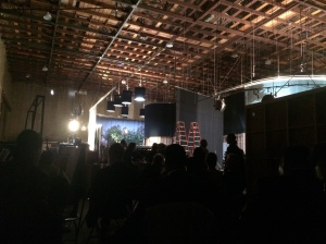 "View of the set from inside the soundstage. The ""house"" is surrounded by backdrops"